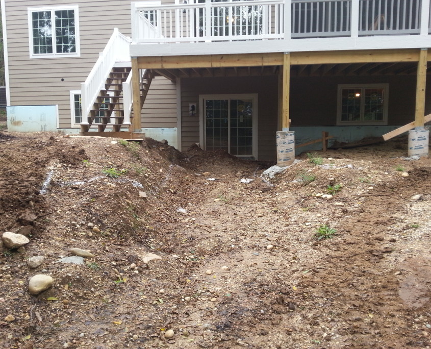 Retaining Wall and Stairs Installation Before