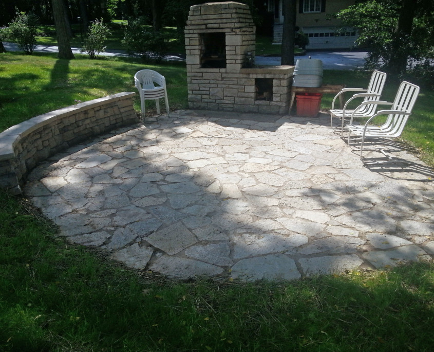 Stone Patio Install with a Bench Wall