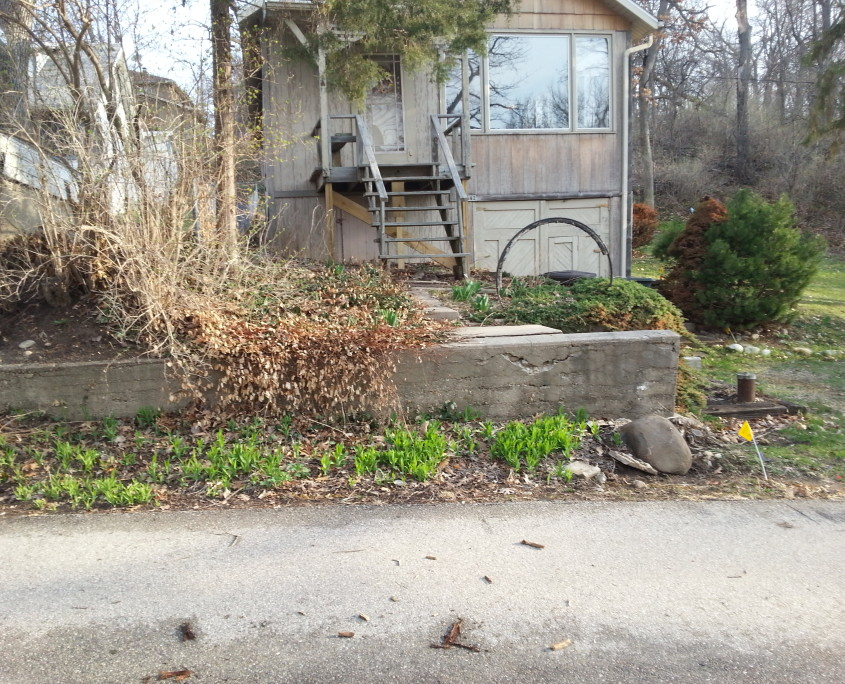 Concrete steps and wall before professional hardscaping