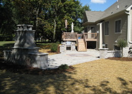 Custom Patio Installation with Outdoor Fireplace & Grilling Area