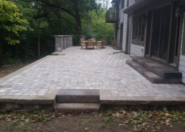 Backyard Patio Installation with Pillars & Fencing